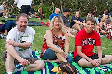 A family enjoying the Family Weekend picnic.