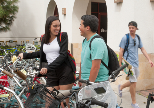 Photo: students posing near bicycle rack