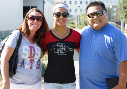 Photo: SDSU Student poses with parents