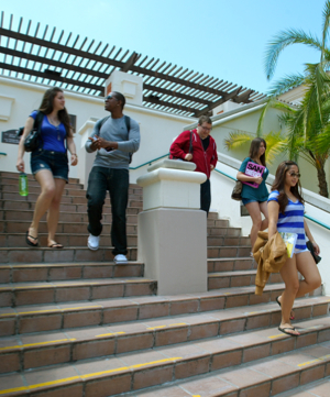 Photo: Students walking down stairs from Financial Aid office