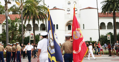 SDSU veterans with flags in front of Hepner Hall