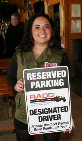 Photo: Radd volunteer holding designated driver sign