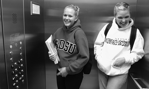 Photo: 2 girls in SDSU elevator