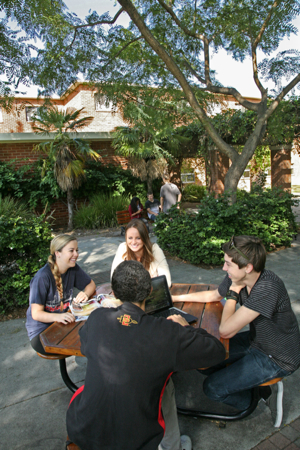 Photo: student group outdoors sitting at table