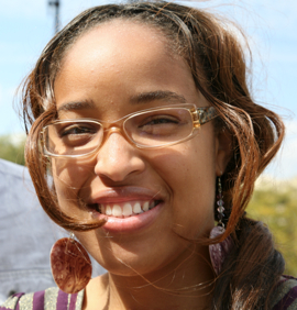 Photo: Young woman with glasses outside