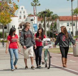 Photo: Students walking on campus with bike