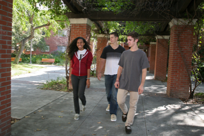 Photo: 3 students walking on campus