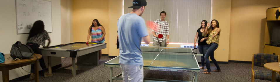 students playing air hockey and ping-pong