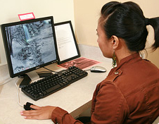 Photo: student practicing biofeedback at a computer