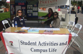 Photo: Student Activities and Campus Life staff in their information tent