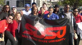 Photo: Students holding up SDSU sign