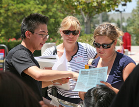 photo: student and parent at orientation