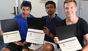 Image: holding graduation certificate