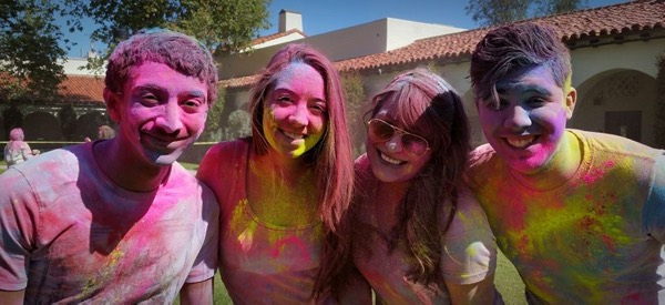 Photo: Students covered in colorful powders at ISC Holi festival