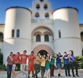 photo: members of the Queer Student Union gather in front of Hepner Hall