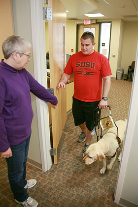 student and guide dog entering the office