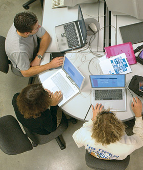 photo: students working on laptop computers