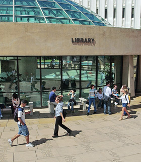 photo: student in front of the library