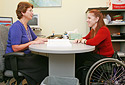 Student in wheelchair meets with an advisor