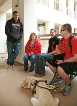 Photo: SDSU students with service dog