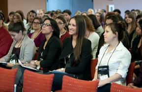 photo: students enjoy a presentation at 2012 leadership summit
