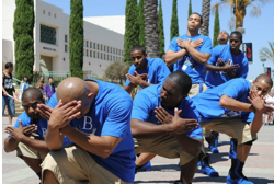 Photo: Greek men's group in blue shirts