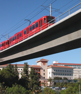 photo: San Diego Trolley crosses a bridge leading to campus