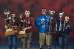 photo of students holding trophies