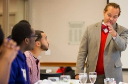 Photo: Aaron Bruce talks with students about study abroad
