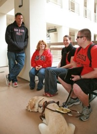 Photo: SDSU student group, one has a service dog