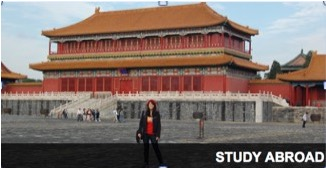 Photo: Student in front of building in Asia
