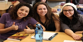 Three CSC Women sitting at desk