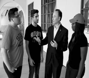 President Elliot Hirshman talks to students.