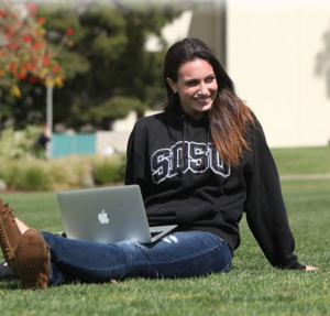 Photo: SDSU student on grass with laptop