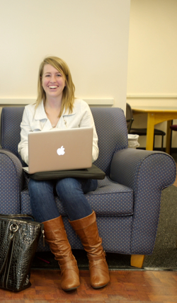 Photo: student in library chair