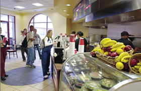 Photo: students ordering food in dining hall