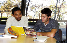 Photo: Student studying with mentor