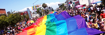 photo of a giant rainbow flag during the San Diego Pride Parade